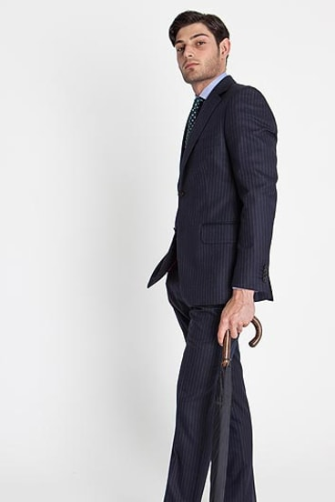Team a pinstripe suit with a classic umbrella for an elegant look.
