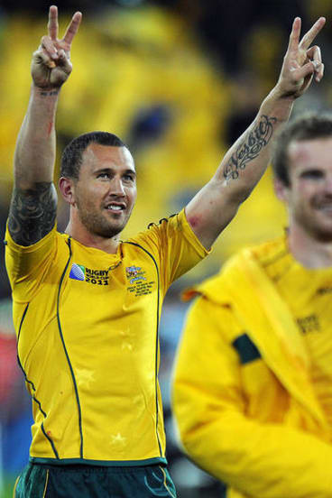 Wallabies fly-half Quade Cooper celebrates after winning the Rugby World Cup quarter-final match against South Africa.