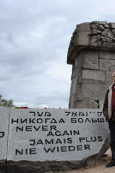A rock and a hard place: Andrew Denton at the memorial built at Treblinka between 1959 and 1963 to pay tribute to the more than 800,000 people who died there.