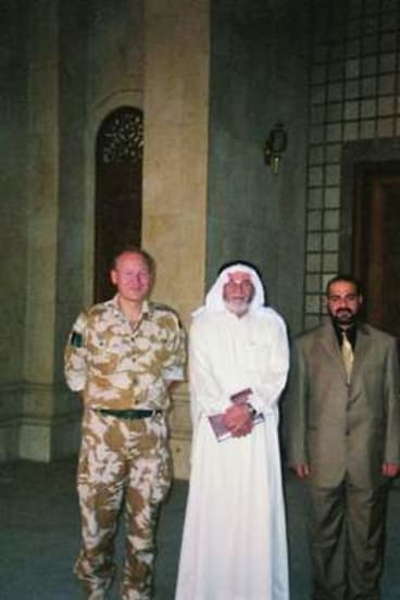 Woman in uniform … in Basra with Siddique's commander, Brigadier John Lorimer, and Sunni elders, who were pursuing a class action against Shiite terrorists.