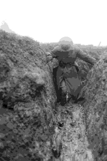 World War 1 war correspondent and historian Charles Bean knee deep in mud in a trench near Gueudecourt in France during the winter of 1916-17.