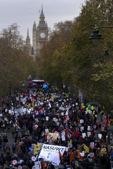 Signs of the times: Protesters carrying placards march through London in a  pension reform strike.