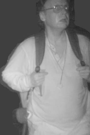 Caught: An image of  Knight from a 2012 surveillance photo.