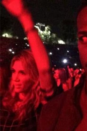 Not impressed: Marlon Wayans captured Delta Goodrem dancing at a Jay Z and Beyonce concert.
