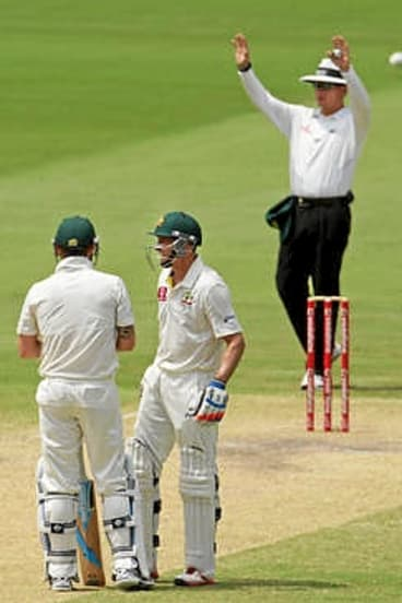 Six more ... Michael Clarke (L) looks on with Michael Hussey after hitting another six  off Imran Tahir.