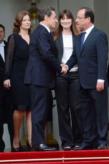 Change afoot … Nicolas Sarkozy and Francois Hollande.