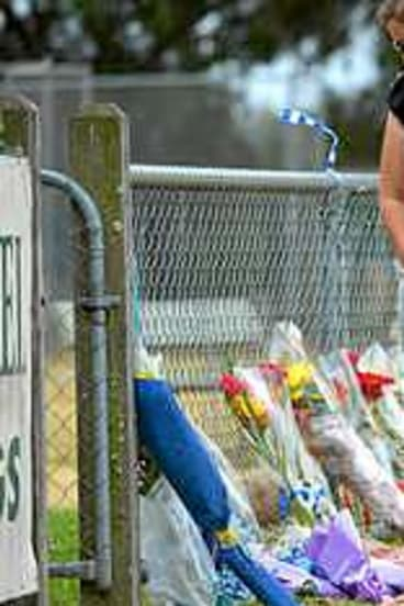 Friends arrive at the Tyabb oval to place flowers near the scene where Luke Batty was killed by his father.