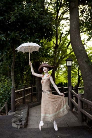 On pointe: Ballerina Amber Scott, posing in Tokyo is part of a new exhibition of dance photography.