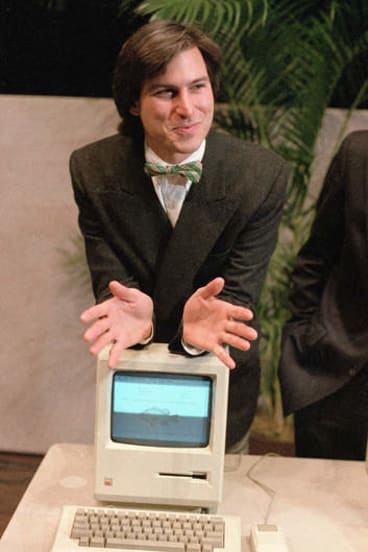 The way we were: Steve Jobs shows shareholders the first Mac, in 1984.