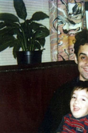 Stephen Crafti with his son in the 1980s in front of the Drysdale curtains in their home.