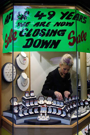 A jewellery shop closes down in Dublin, a common sight in the once economically robust city.