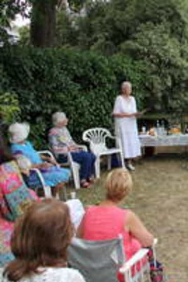 PORTRAIT: Dorothy Collings reads Rex Ingamells' biography to residents.