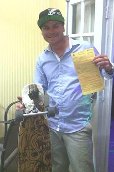 Eddie McDonald with his skateboard.