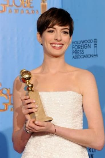 Anne Hathaway with the Golden Globe she won for <i>Les Miserables</i> in 2013.