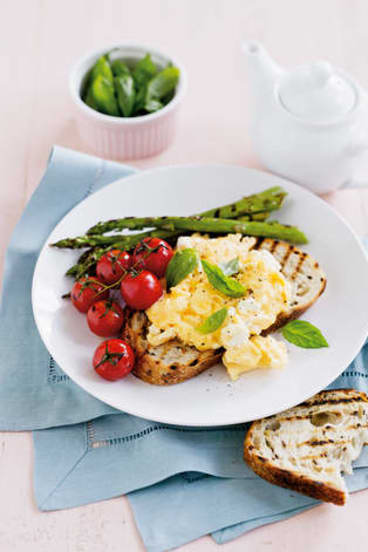 Egged on … scrambled eggs with asparagus and tomatoes.