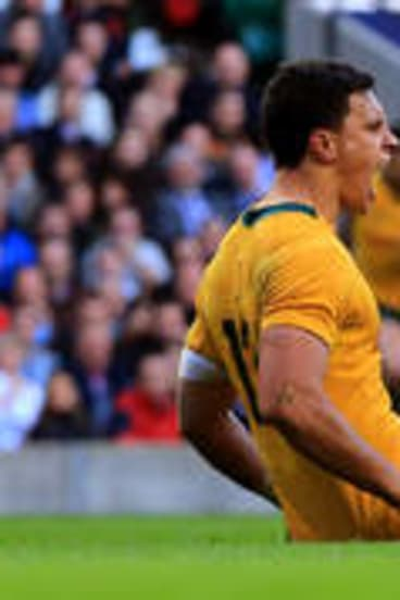 Real find: Matt Toomua celebrates after scoring the opening try for the Wallabies despite the tackle from Chris Robshaw.