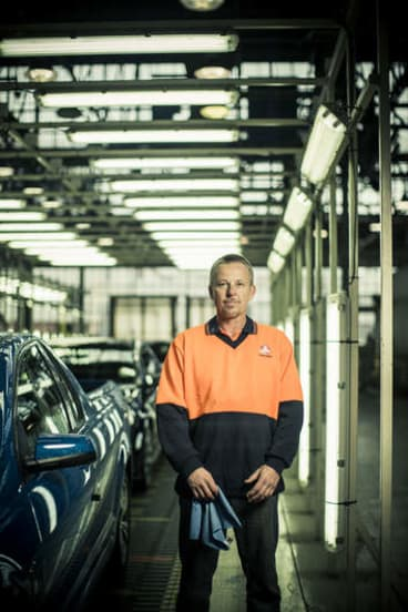 Check, mate … quality checker Tony Poole at Holden's Elizabeth plant in Adelaide's far north.