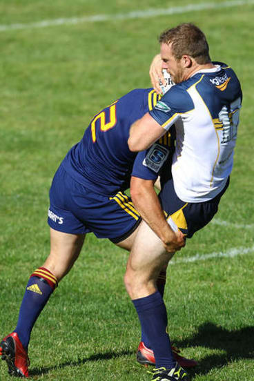 Pat McCabe of the Brumbies is tackled during the Super Rugby trial match between the Highlanders on January 31.