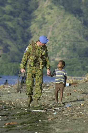 There has been a seemingly endless photo album of Australian peacekeepers with small foreign children.