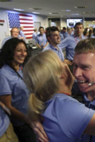 Members of the NASA team celebrate the successful landing on Mars.