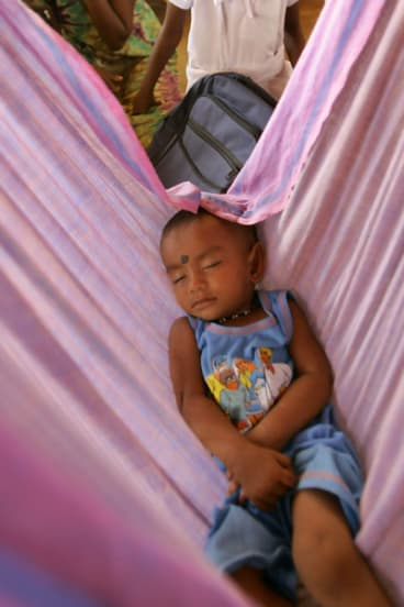 A Tamil child sleeps in a refugee camp in Sri Lanka. The conditions in these camps have been cited as a reason for the exodus of Tamils from the country.