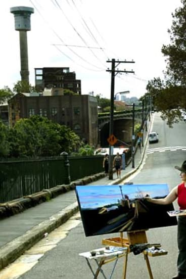 Not going to be a water feature for long: Sydney Ports' artist-in-residence Jane Bennett paints the MSB Tower.