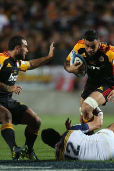 Coming through: Liam Messam of the Chiefs charges with the ball against the Brumbies in the Super Rugby final.