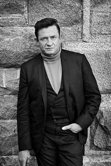 Johnny Cash outside Folsom Prison 1968by Jim Marshall.