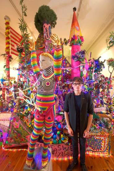 Paul Yore with his art installation <i>Everything's F...ed</i>.
