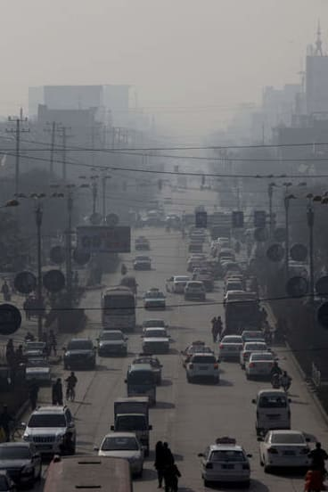 Traffic moves through a thick haze in Linfen, Shanxi province, China.