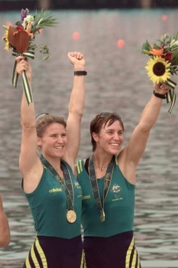 Australia's Gold medalists Megan Still (L) and Kate Slatter (R) in the women coxless pairs celebrate during the medals ceremony, July 27.  USA won the Silver and France the Bronze in the event.