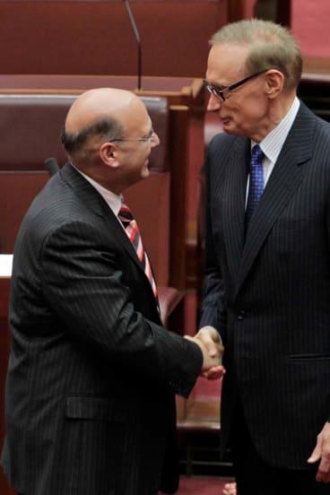 Senator Bob Carr is congratulated by NSW Liberal Senator Arthur Sinodinos after he was sworn in as a NSW senator.