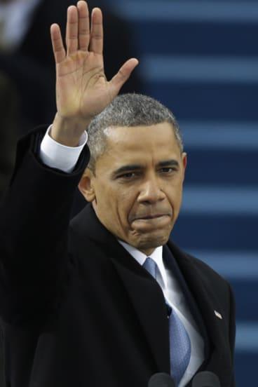 President Barack Obama waves after his inauguration speech in Washington, Monday, Jan. 21, 2013.