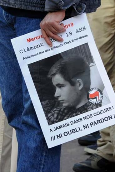 A demonstrator holds a poster of Clement Meric during a protest rally in Paris.