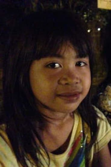Lisa, 6, and Risa, 7, are forced to beg on the streets of Kuta.
