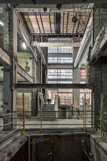 Photos in the Occupied exhibition show what looks like a blown-up building: the RMIT New Academic Street in the process of redevelopment.