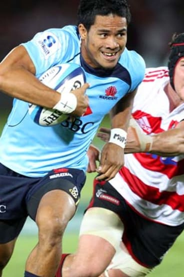 Afa Pakalani of the Waratahs beats the tackle of Matt Todd of the Crusaders to score.