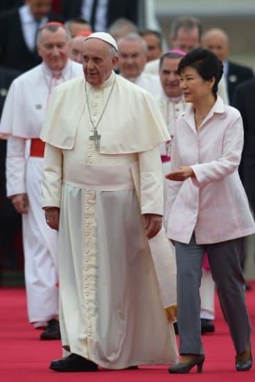 South Korean President Park Geun-hye escorts Pope Francis following his arrival in Seongnam.