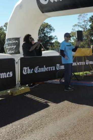 Winner, Samuel Gebremichael, crosses the line.