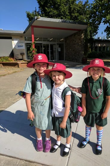 Freyja Christiansen  got to have one day at kindy at Yarralumla Primary School before starting cancer treatment. She is with her big sisters Brynn, and Inge,