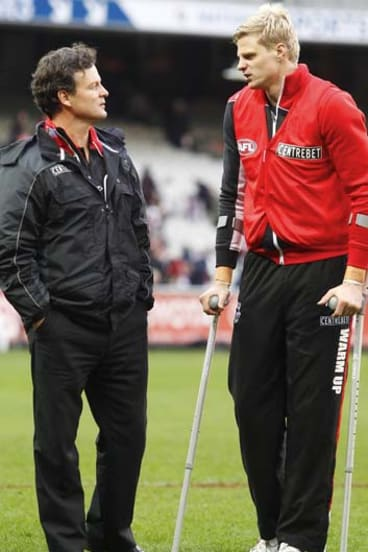 St Kilda captain Nick Riewoldt talks to coach Scott Watters after the match against  Melbourne on Saturday.