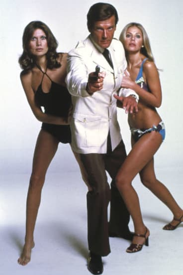 Shaken, not stirred ... Roger Moore as James Bond in a scene from the 1974 movie <i>The Man with the Golden Gun</i>, co-starring Maud Adams and Britt Ekland.