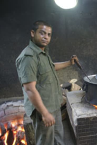 Manoj Kalander prepares the bear's meals.