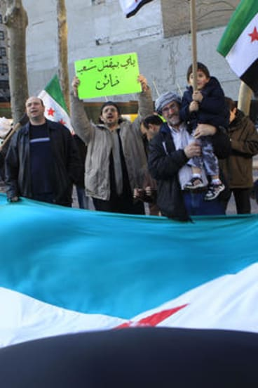 Demonstrators chant slogans and wave Syrian flags outside United Nations headquarters in New York.