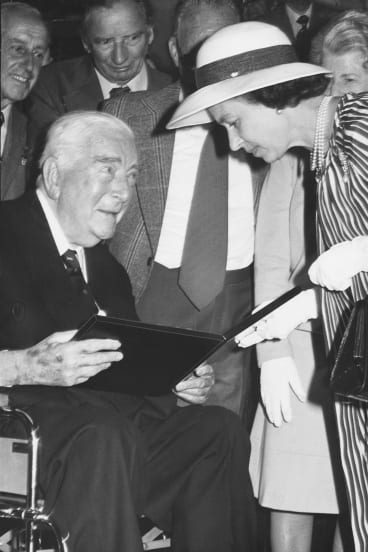 The Queen invested Sir Robert Menzies as a Knight of the Order of Australia in a ceremony in the Long Room at the MCG in 1977.