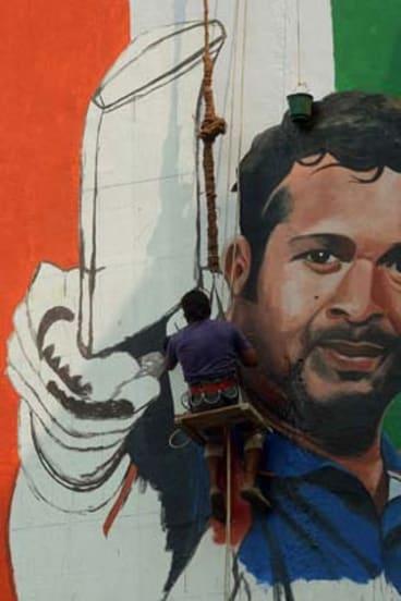 Image of a champion: artist Ranjit Dahiya paints a mural of Sachin Tendulkar on a wall in Mumbai.