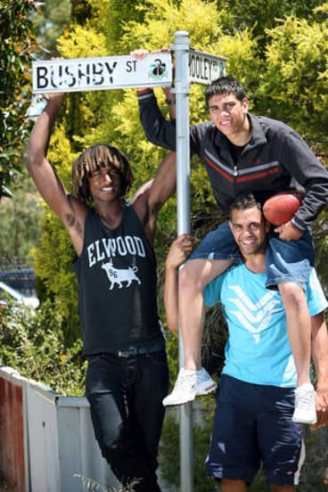 A 2008 image shows Nick Naitanui, Chris Yarran with Michael Walters on his shoulders in Bushby Street in Midvale, where they all grew up.