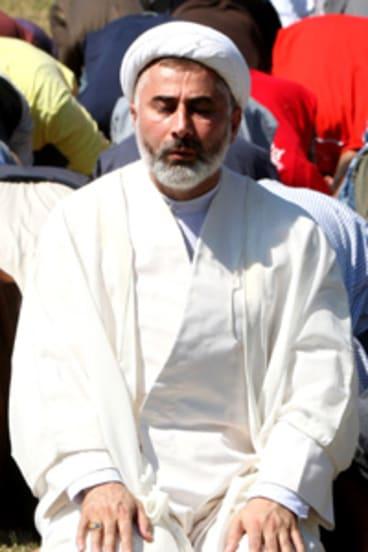 Sheikh Mansour Leghael at prayer.