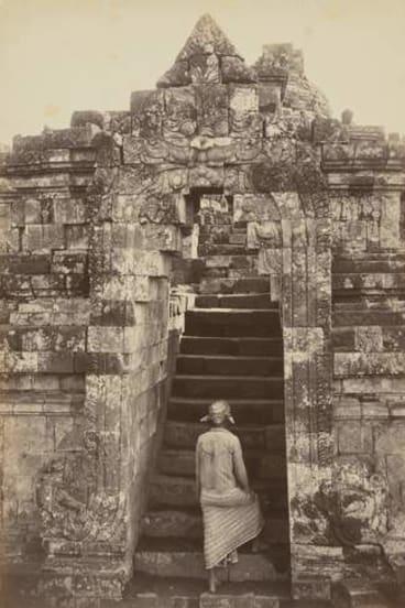 <i>Man climbing the front entrance to Borubdur</i> by Kassian Cephas.