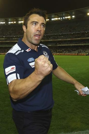 Geelong coach Chris Scott celebrates his team's  victory over St Kilda in round one.